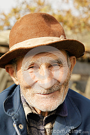 Positive senior man in hat