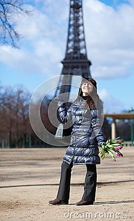Positive tourist in Paris, near the Eiffel tower