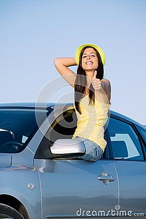 Positive woman on car travel