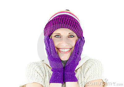 Positive woman with a colorful hat and a pullover