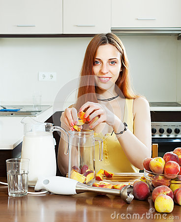 Positive woman cooking  from peaches