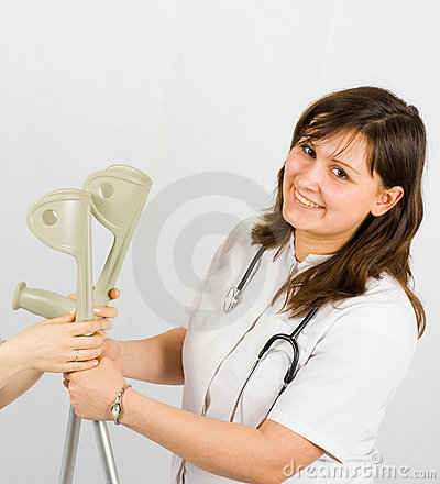 Positive woman hands crutches to her patient