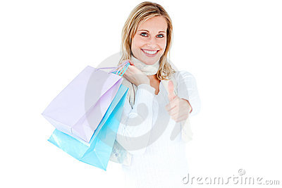 Positive woman with shopping bags and thumb up