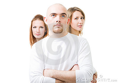 Positive young man with two women