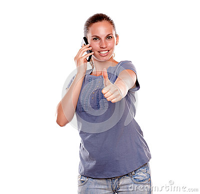 Positive young woman speaking on mobile phone
