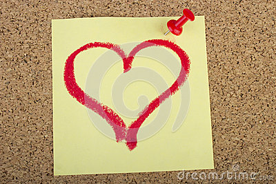 Post-it with heart shape drawn with lipstick