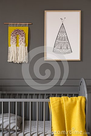 Free Poster Above Child`s Bed With Yellow Blanket In Grey Bedroom Int Royalty Free Stock Images - 126408709