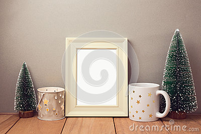 Poster mock up template for Christmas holiday with cup and small pine trees Stock Photo
