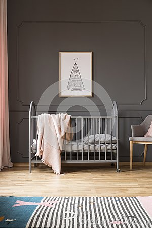 Free Poster On Grey Wall Above Bed With Pink Blanket In Baby`s Bedroo Royalty Free Stock Images - 126408559