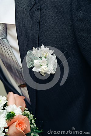 Posy with roses on groom suit