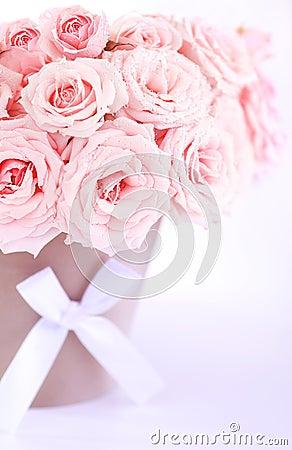 Pot of pink wet roses