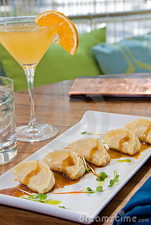 Pot stickers with an orange martini