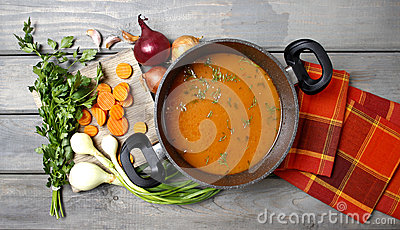 Pot of tomato soup and fresh vegetables