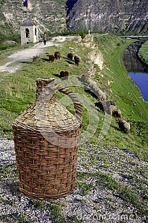 Pot of wine in front of moldavian landscape