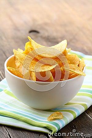 Potato chips in a white bowl