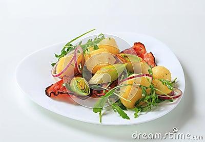 Potatoes with leek and arugula