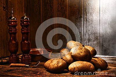 Potatoes on Old Wood Table in an Antique Kitchen