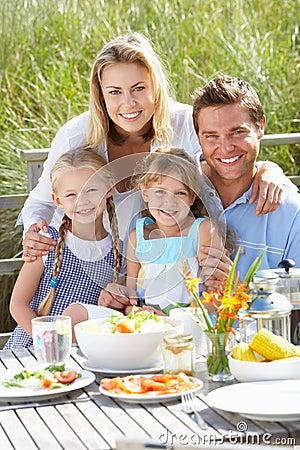 Potrait of family enjoying a meal outside