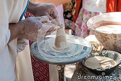 Potter guiding pottery