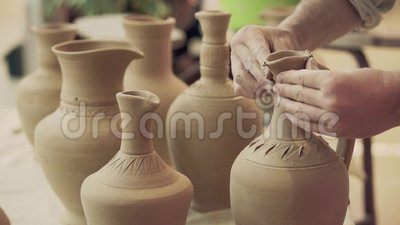 Potter works. Crockery creation process in pottery on potters wheel stock video