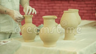 Potter works. Crockery creation process in pottery on potters wheel stock footage