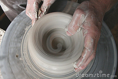Potters hands on wheel