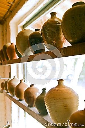Pottery vases on shelf