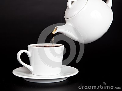 Pour tea from the teapot into the cup