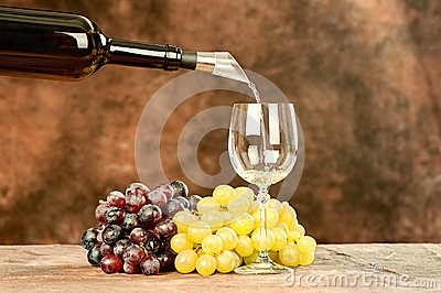 Pour wine in cup