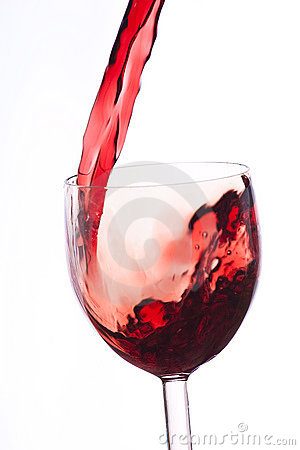 Pour the wine into the glass on a white background