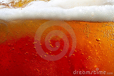 Pouring beer with bubbles and froth