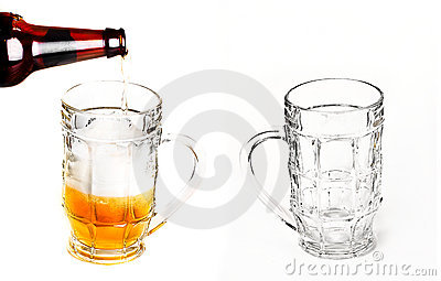 Pouring beer into mug and empty glass for beer
