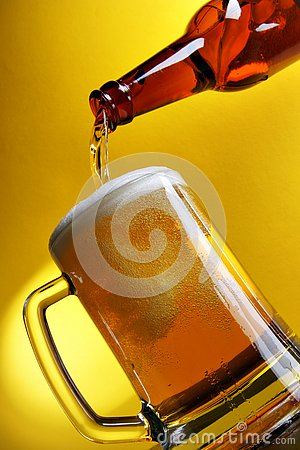 Free Pouring Beer Over Yellow Royalty Free Stock Image - 4049256