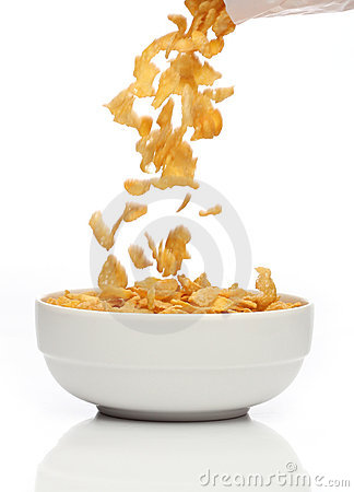 Pouring cornflakes into a bowl,