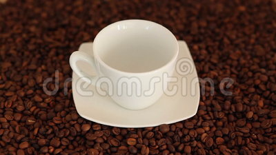 Pouring a cup of fresh hot coffee. Surrounded by coffee beans. High Angle View,Tripod stock footage