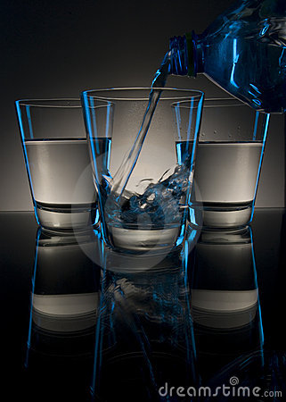 Pouring drink in glass