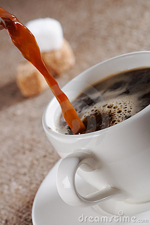 Pouring  Fresh  Brewed Coffee in white cup
