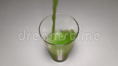Pouring Fresh Green Celery Juice into Glass  Antioxidant Vegan Plant Based  Diet for Cleansing Body and Weight Loss