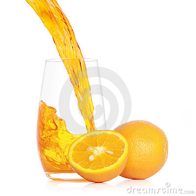 Pouring fresh orange juice into a glass