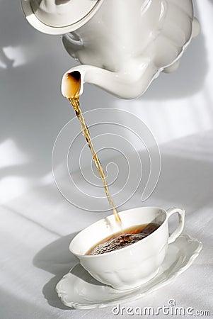 Pouring fresh tea.