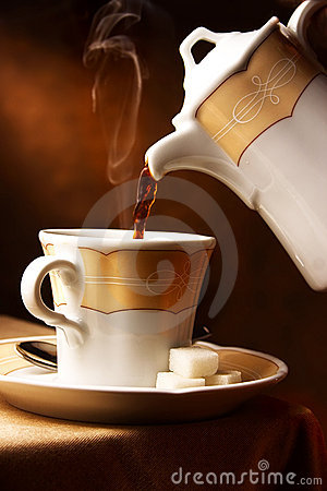 Hot coffee pouring in a cup