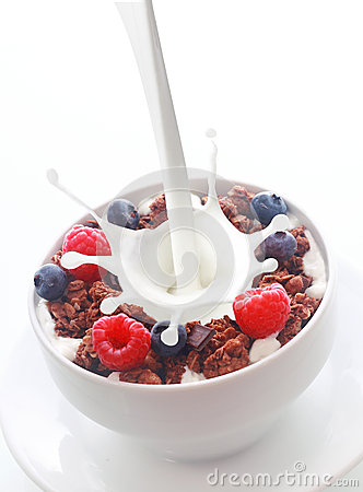 Free Pouring Milk Into Breakfast Cereal With Berries Royalty Free Stock Images - 44571419