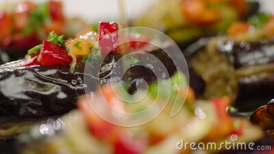 Pouring olive oil over stuffed eggplant. Original name: Zeytinyagli Imam Bayildi