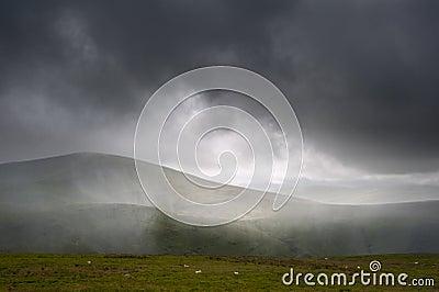 Pouring rain in mountain landscape