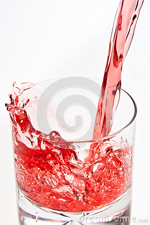 Pouring a red beverage