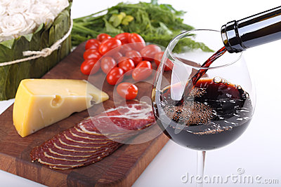 Pouring red wine and food bachground