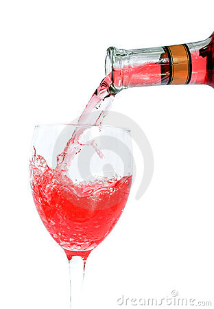 Pouring red wine on a glass