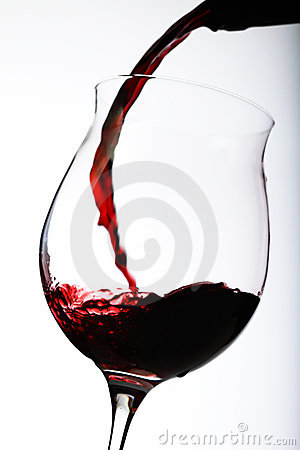 Free Pouring Red Wine In A Glass Stock Image - 17391891