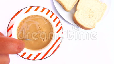 Pouring sugar Into a Cup of Coffee For Breakfast stock footage