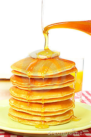 Pouring syrup on the pancakes